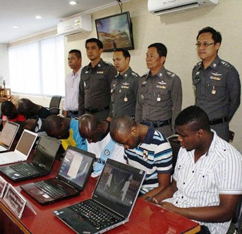 Seven Africans arrested for allegedly swindling 10 million baht from Thai women are presented at a police news conference in Pattaya on Saturday. (Photo by Trinai Jansrichol)