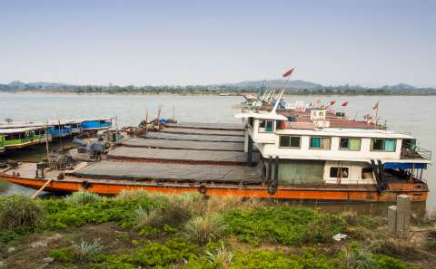 Chinese-flagged river boats tied up in the port in Chiang Saen