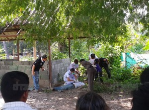 The three reportedly confessed to murdering Thet Soe and re-enacted their crime around noon on 3 March.