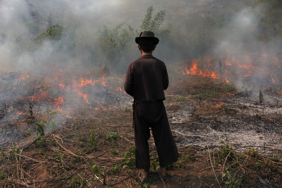 Farmer Burns Field in Chiang Rai prior to planting rice