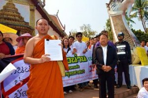 Buddhist monk, who represented the demonstrators, handed a protest letter to a provincial officer.