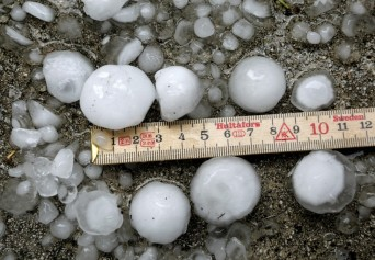 Heavy rain and massive hailstones the size of golf balls damaged the roofs of 235 houses