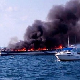 The Phuket-Krabi tourist ferry blazes after passengers jumped for their lives Photo by Chao Fa Rescue Krabi
