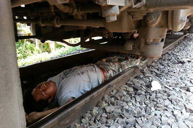 Suicidal Man Jumps in Front Train, Only to Survive Unharmed