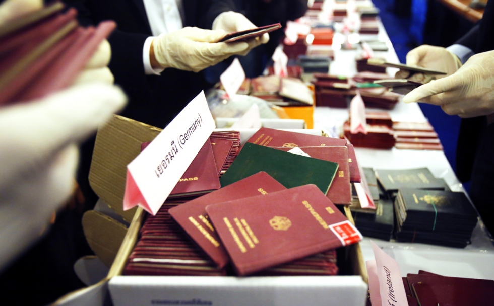 Department of Special Investigation officers display stolen passports during a press conference at the Department of Special Investigation Headquarters in Bangkok, Thailand.
