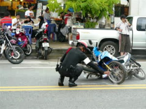 stock-footage-ao-nang-april-policeman-at-the-scene-of-motorbikes-crash-ao-nang-beach-krabi-province