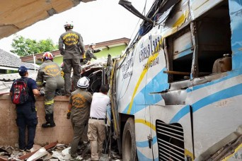 Rescue workers look for injured on passenger bus