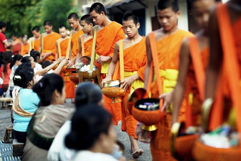 Thailand's 38,000 temples traditionally rely on donations from the faithful