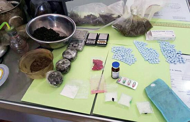 Pic shows: The British citizen was detained on Thursday evening in his rented room in Sangkat 3 commune where a police raid allegedly uncovered 12 grams of methamphetamine, three packets of ketamine, 57 tablets, a bottle of marijuana oil and drug scales. A British man has been arrested in Cambodia for drug dealing. Emery William, 48, who lives in the coastal town of Sikanoukville in the South West was busted by narcotics police. They seized a large amount of drugs during the raid including 356 amphetamine pills which are smoked, as well as liquid ketamine, 12.3 grams of crystal meth and also a mobile phone, cash and drug paraphernalia. The raid came after a tip-off and was led by Choun Narin, the local police chief. Amphetamine pills and crystal meth are widespread in the resort and sold to tourists and residents. They can be bought openly from motorcycle taxi drivers, tuk-tuk drivers and they are also available at nightspots along  Serendipity beach. Although Cambodia does not have the death penalty for drug trafficking, it is still one of the countries with the harshest anti-drug laws in the world with those convicted sentenced to lengthy sentences and very often life in prison for possessing drugs. (ends)