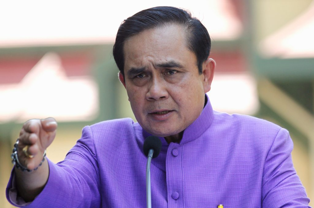 Thailand's Prime Minister Prayuth Chan-ocha answers questions from reporters during a press conference at the government house in Bangkok, Thailand