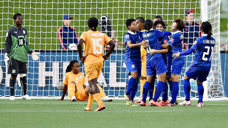 Orathai Srimanee of Thailand celebrates with teammates after scoring her second goal vs. the Ivory Coast