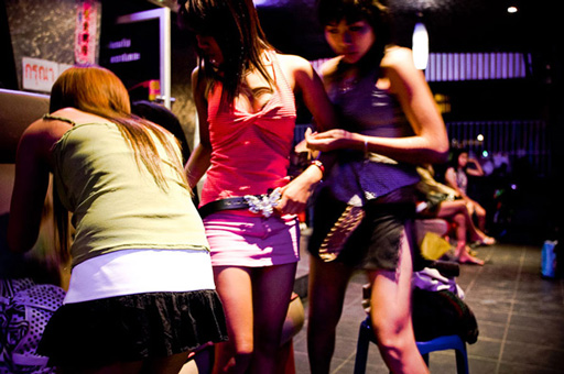 young women prepare for a night of work at the Violin Karaoke bar in Chiang Mai