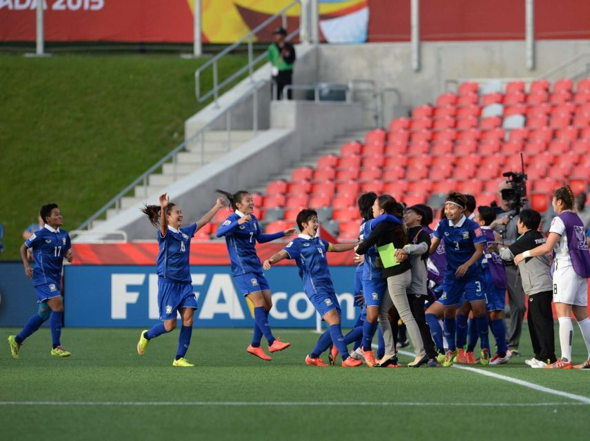 Thailand players run to the sidelines to celebrate after scoring a goal against Ivory Coast during the first half of a FIFA Women's World Cup match in Ottawa, Ontario, Canada