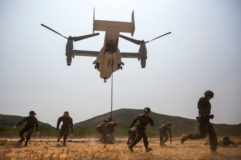 U.S. Marines evacuate the area as an MV-22B Osprey prepares to land at Hat Yao, Thailand, in February during Exercise Cobra Gold 2014
