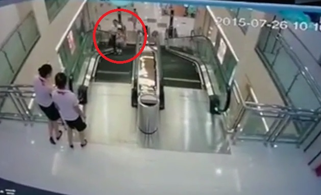 Chinese Woman Saves Her 2 Year Old Son Before Falling into Escalator