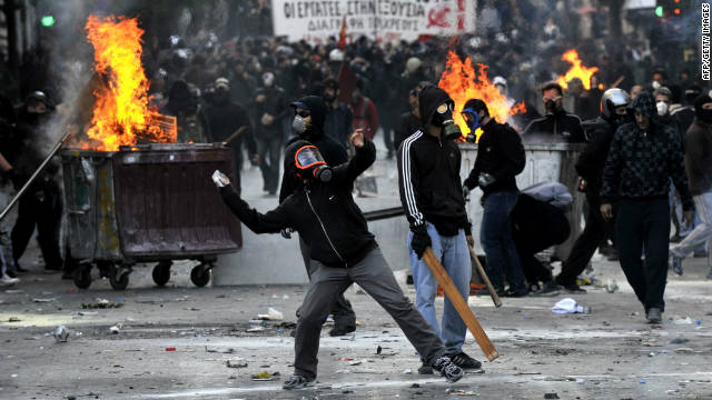 Police clash with masked demonstrators in Athens