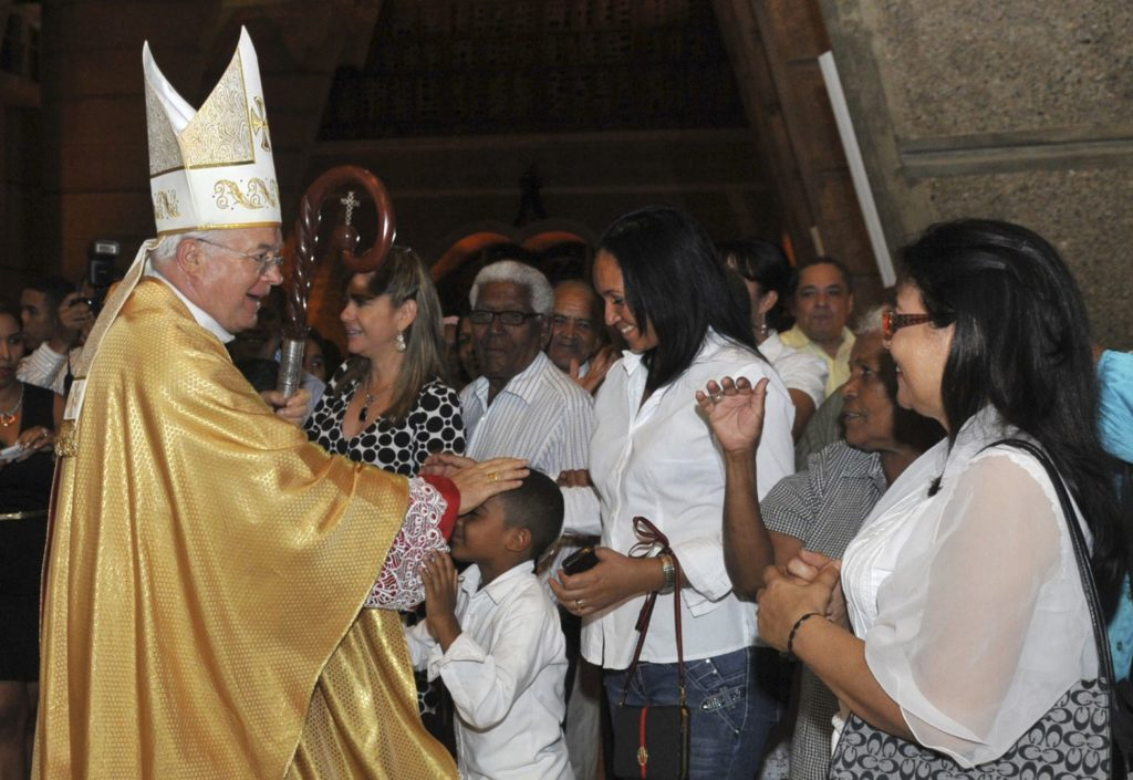 Archbishop Josef Wesolowski, papal nuncio for the Dominican Republic, greets people after a Mass in Santo Domingo