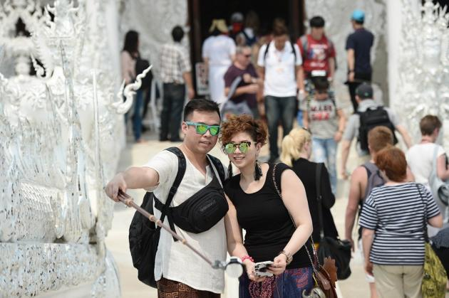 Couple Take Selfies at White \temple in Chiang Rai
