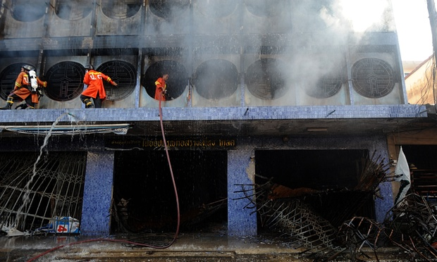 Thai firefighters spray water on burning buildings from a bomb attack by suspected separatist militants in Sungai Kolok, in Thailand�s southern province of Narathiwat