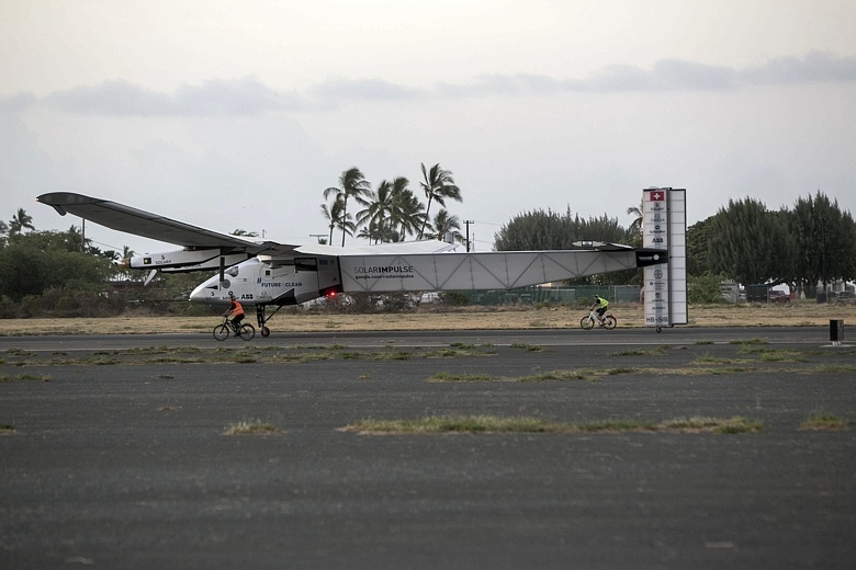 The Solar Impulse 2, piloted by Andre Borschberg, lands at Kalaeloa Airport, Hawaii