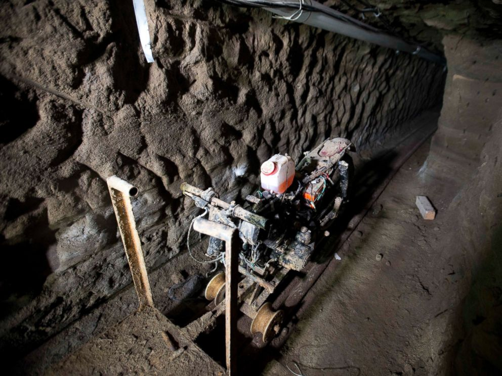 """A motorcycle adapted to a rail sits in the tunnel under the half-built house where according to authorities, drug lord Joaquin """"El Chapo"""" Guzman made his escape from the Altiplano maximum security prison in Almoloya, Mexico"""