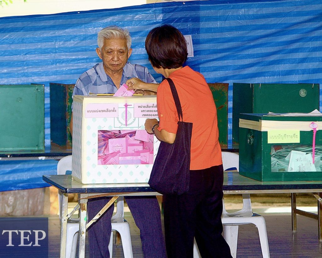 A voter deposits her vote in the 2011 Thailand general election