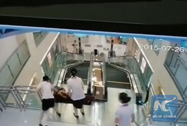 assistant attempted to pull Xiang up from the floor but she was swiftly swallowed by the escalator