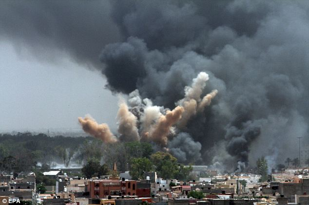Smoke rises in the sky after a NATO air strike in Tripoli