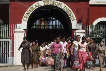 Myanmar prisoners walk out of Insein Prison after they were granted amnesty from the government