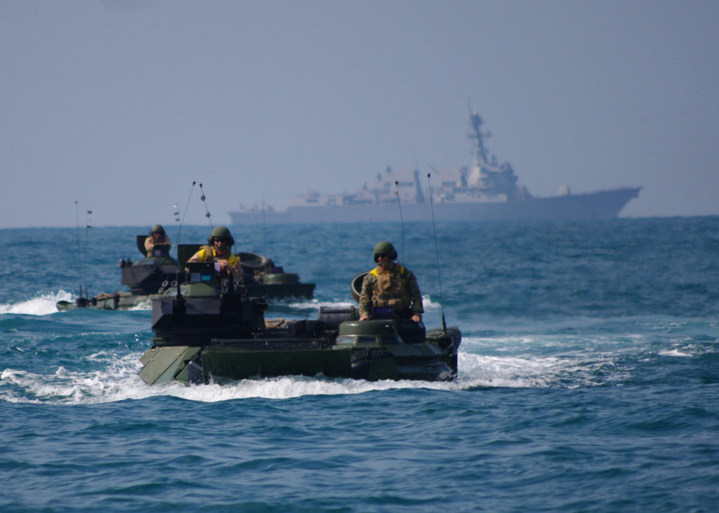 Amphibious assault vehicles from the amphibious transport dock ship USS Denver (LPD 9) participate in an amphibious exercise in the South China Sea