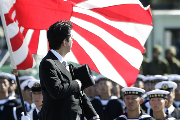 Japanese Prime Minister Shinzo Abe reviews members of Japan's Self-Defense Forces (SDF) during the Self-Defense Forces Day at Asaka Base, north of Tokyo, Oct. 27, 2013 (AP photo by Shizuo Kambayashi).