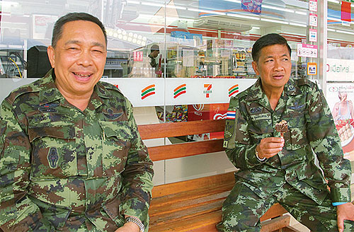 Thai General Tawatchai Samutsakhon (L) says student brainwashed