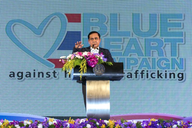 Thailand's Prime Minister Prayuth Chan-ocha gestures as he speaks during a ceremony marking the National Anti-Human Trafficking Day