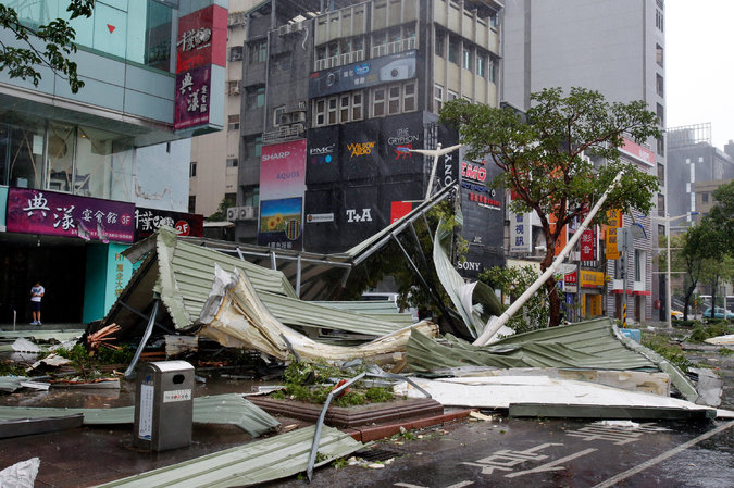 Damage from Typhoon Soudelor in Taipei, Taiwan, on Saturday. The storm weakened as it crossed the island and headed toward China