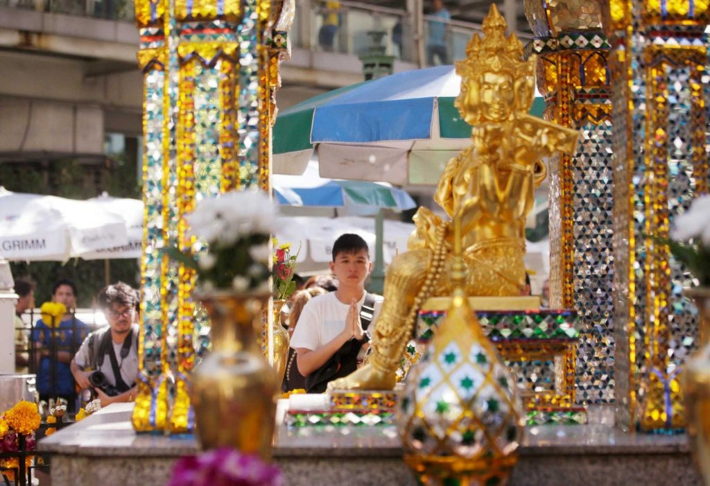 A man prays at the Erawan Shrine at Rajprasong intersection in Bangkok