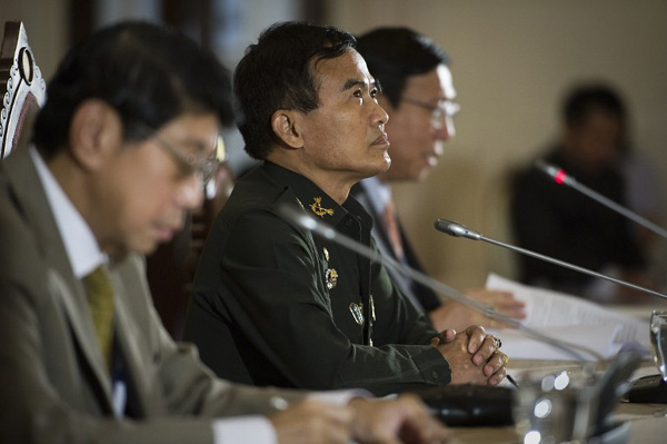 Members of the National Council for Peace and Order (L-R) Wissanu Krea-ngam, General Paiboon Khumchaya and Pornpetch Wichitcholchai speak to the media during a press conference at Government House in Bangkok.