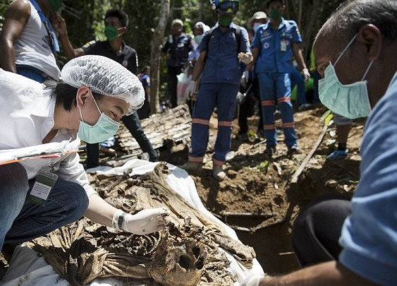 The graves were found in the state of Perlis near the Thai border not far from 139 grave sites unearthed in May, Perlis