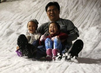 Youngsters' faces lit up as they got to experience the sub-zero magical landscape at the Snow Town which opened this month  Read more: http://www.dailymail.co.uk/travel/travel_news/article-3180275/The-heartwarming-moment-children-tropical-Thailand-snow-time-thanks-winter-theme-park.html#ixzz3hZP1phIr Follow us: @MailOnline on Twitter   DailyMail on Facebook