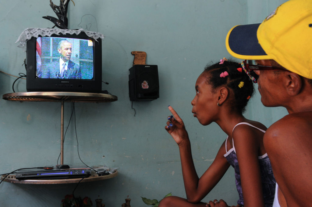 "Cubans watch US President Barack Obama talking on TV about the reestablishment of full diplomatic ties with Cuba, in Havana on July 1, 2015. President Barack Obama announced that the United States and Cuba will re-establish full diplomatic relations, severed 54 years ago in the angry heat of the Cold War. The US president and Cuban state television simultaneously announced the landmark agreement, aimed at easing decades of enmity across the narrow Straits of Florida. Under the deal, embassies in Washington and Havana will be reopened as soon as July 20, in what Obama described as a ""historic step forward,"" and a ""new chapter"" in US relations with Latin America.   AFP PHOTO / YAMIL LAGEYAMIL LAGE/AFP/Getty Images"