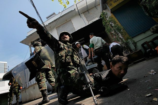 An anti-government demonstrator is arrested by Thai soldiers in downtown Bangkok, Thailand.