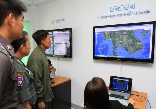 A Narcotics Control Board officer demonstrates how information on the Mekong River is tracked