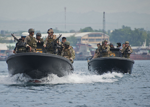 U.S. Navy Riverine Squadron 3 work with members of Philippine Navy Seal Team 7 during a patrolling and formation training