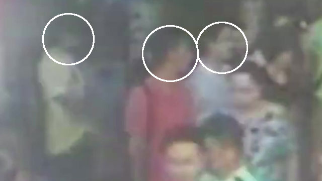 The pair were seen in security camera, insist they are tour guides,