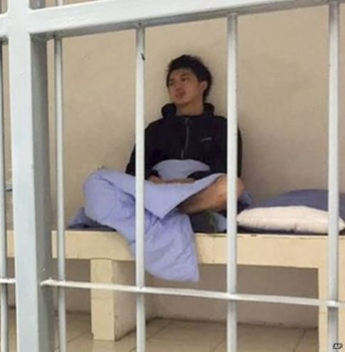 In his image provided by Initium Media Technology, Hong Kong journalist Hok Chun Anthony Kwan sits in a cell Monday after he was detained Sunday at Suvarnabhumi airport for carrying body armour and a helmet... Please credit and share this article with others using this link:http://www.bangkokpost.com/news/general/667092/hk-photographer-bailed-after-arrest-for-ballistic-vest. View our policies at http://goo.gl/9HgTd and http://goo.gl/ou6Ip. © Post Publishing PCL. All rights reserved.