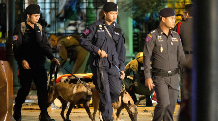 Police investigate the scene after an explosion in Bangkok, Monday, Aug. 17, 2015