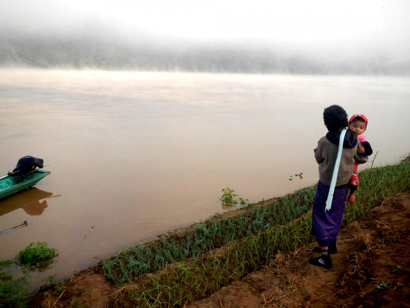 Villager overlooks the Banks of the Mekong in Chiang Rai