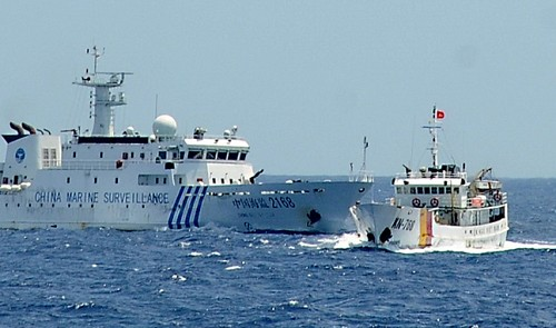 Chinese marine surveillance ship 2168 (L) attempts to ram Vietnamese fisheries surveillance boat