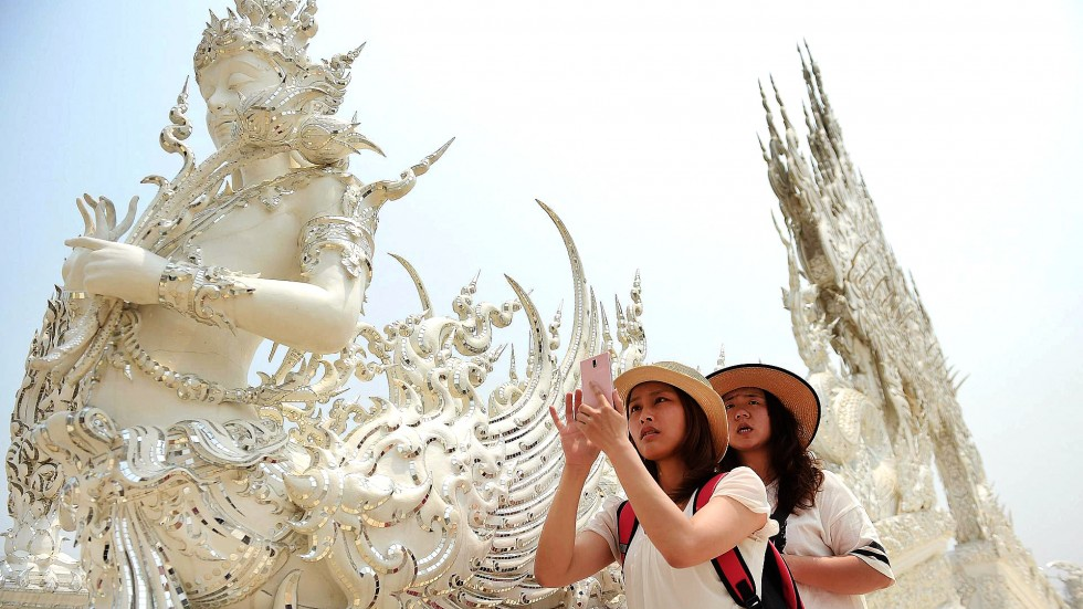 Thai Tourists visit Wat Rong Khun temple