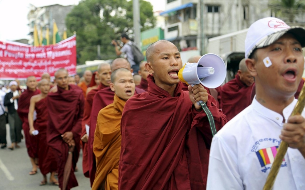 Monks and protesters shout during a march to denounce foreign criticism of the country's treatment of stateless Rohingya Muslims, in Yangon, Myanmar