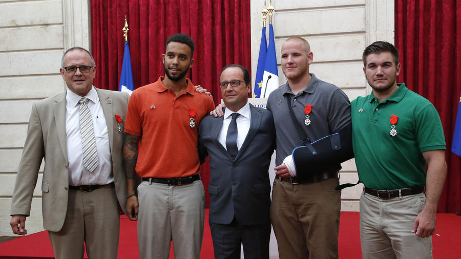 Spencer Stone, 23, Alek Skarlatos, 22, and Anthony Sadler, 23, three friends on a European vacation, and British businessman Chris Norman, 62, were awarded the Legion d'Honneur by French President François Hollande at the Elysée Palace.